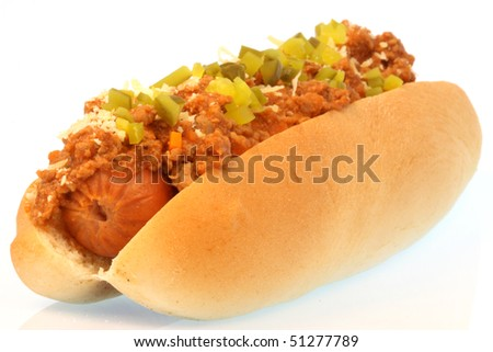 hot dog against white background with chili , onions and pickles on top