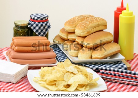 hot dog ingredients on a nice table setting rich in colors and flavors