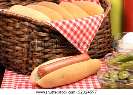 hot dog ingredients on a nice table setting rich in colors and flavors perfect for picknicks