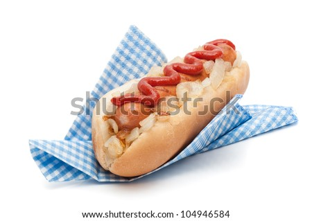 Hot dog roll with fried onions and tomato sauce in napkin on a white background