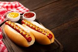Hot dog with ketchup and yellow mustard.