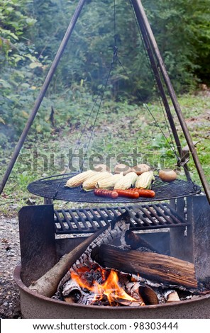 Hot dogs,corn and potatoes cooking on a grill at a Pennsylvania State Park.