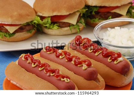 Hot dogs,hamburgers and ingredients. Fast food composition.