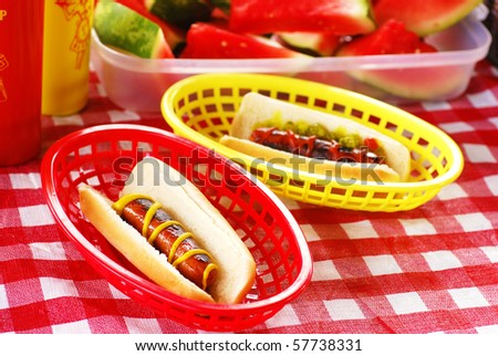 Hot dogs with ketchup and mustard on a picnic table