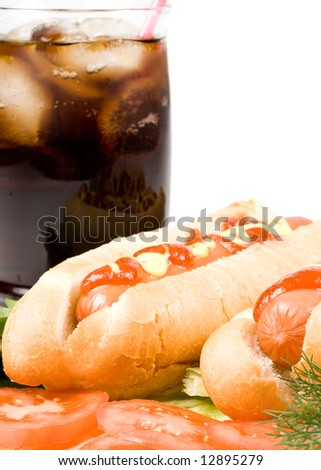Hot dogs with vegetables and  a glass of cola  with ice isolated on a white background