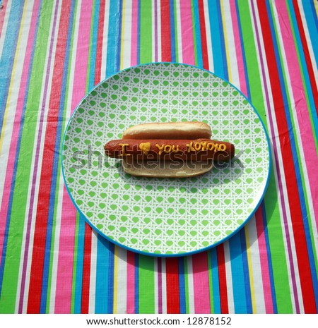 Hot Dogs with Words and Slogans written in Yellow Mustard \