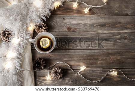 Hot drink and christmas decoration on the wooden background #533769478