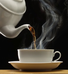 Hot drink cup on black background.