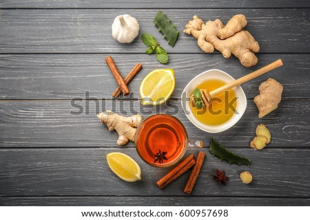 Hot drink with honey, lemon and ginger for cough remedy on wooden table Stockfoto ©