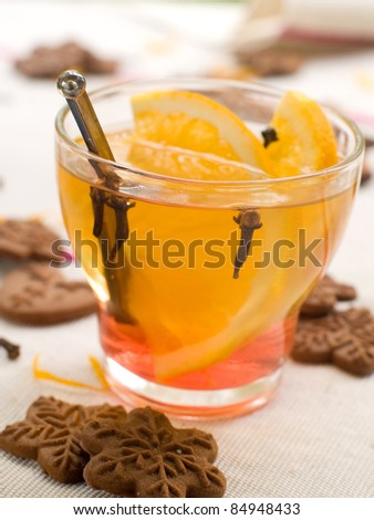 Hot drink with orange and ginger cookies. Selective focus - stock photo