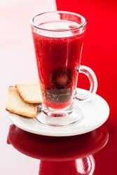 Hot drink with plum and cookies