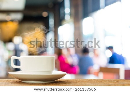 Hot espresso on the table with people do meeting business plan in coffee shop background  #261139586
