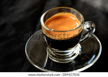hot espresso shot on black background