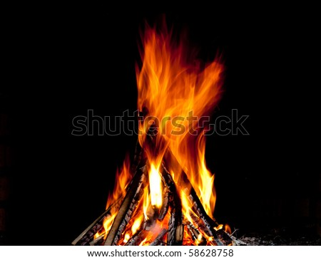 Hot fireplace full of fire wood