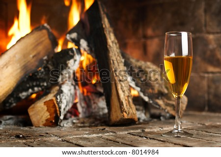 Hot fireplace full of fire wood and fire - stock photo