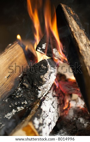 Hot fireplace full of fire wood and fire