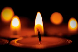 Hot flames of candles in dark room