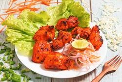 Hot & fresh Chicken Tikka kebab with salad and chutney
