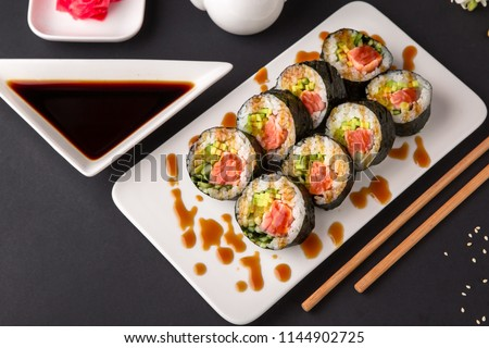 Hot fried Sushi Roll with salmon, tuna, avocado and cheese. Sushi menu. Japanese food.