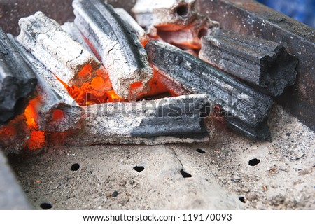 Hot glowing charcoal briquettes.