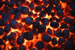 Hot Glowing Charcoal Briquettes Texture And Background, Top View, Close Up