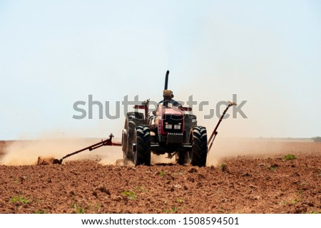 Hot heat summer sun ploughing fields in Kwazulu Natal South Africa, dusty movement blur, tractors, machinery #1508594501