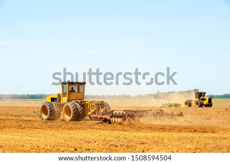 Hot heat summer sun ploughing fields in Kwazulu Natal South Africa, dusty movement blur, tractors, machinery #1508594504