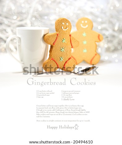 Hot holiday drink with gingerbread cookies on festive cookie recipe - stock photo