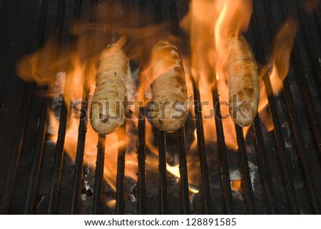 Hot Italian Sausage BBQ with flames