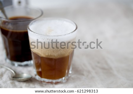 Hot latte and black coffee on white background. Morning concept #621298313