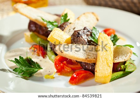 Hot Meat Dishes - Beef Medallions with French Fries, Vegetables and Sauce