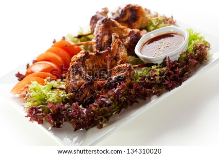 Hot Meat Dishes - Fried Chicken Wings with Salad Leaves, Tomatoes and ...
