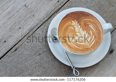 hot milk art coffee on wooden table