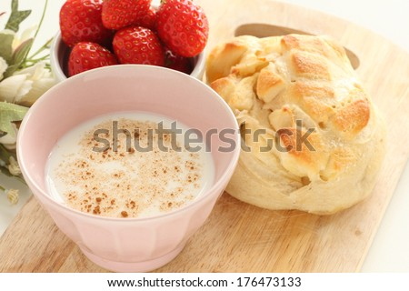 hot milk with cinnamon powder and bread for breakfast image