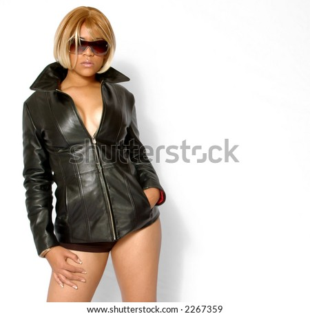 Hot Model with black leather coat and sunglasses (Copy space to the right)