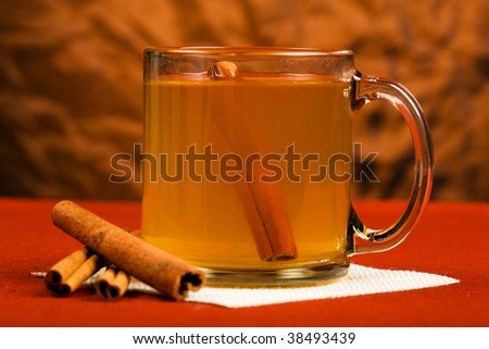 Hot mulled apple cider with cinnamon stick