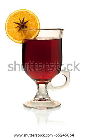 Hot mulled wine with orange slice and anise. Isolated on white