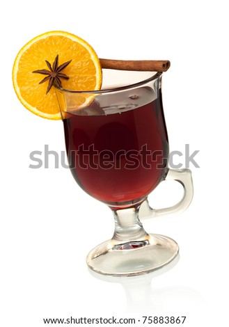 Hot mulled wine with orange slice, anise and cinnamon. Isolated on white