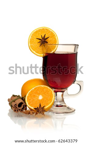 Hot mulled wine with oranges, anise and cinnamon. Isolated on white