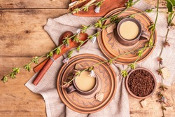Hot natural chicory caffeine free drink in ceramic cups on a wooden table. Healthy alternative replacement for coffee, caffeine. Blue chicory flowers, fresh roots, top view