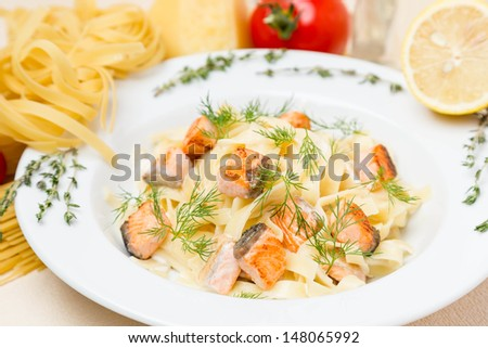 hot pasta with garnish on white plate
