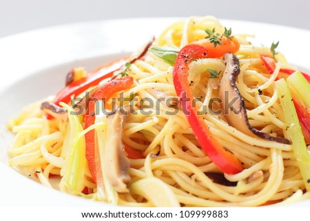 hot pasta with pepper and cucumber on white dish