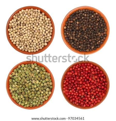hot pepper, red pepper, black pepper, white pepper, green pepper, in a clay bowl, isolated, white background, texture