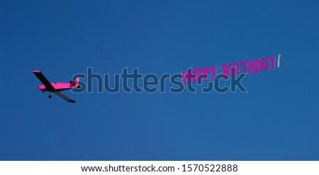 Hot pink airplane with Happy Birthday message, Miami Beach, Florida, USA