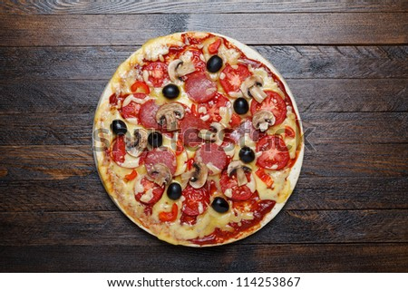 hot pizza on wooden table