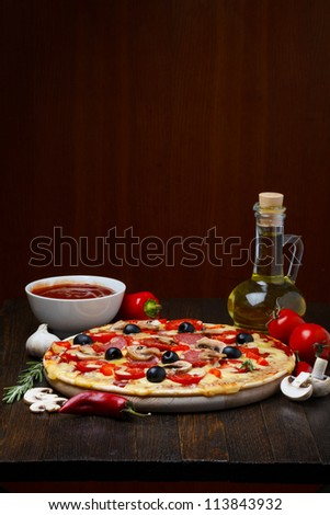 hot pizza with ingredients - stock photo