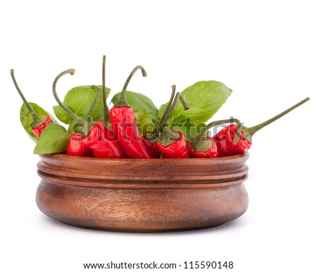 Hot red chili or chilli pepper in wooden bowl isolated on white background cutout