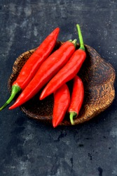 Hot red chili or chilli pepper isolated on black background.