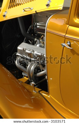hot rod with hood up and engine exposed