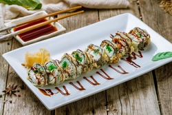 Hot Roll with chukka on white plate on old wooden table